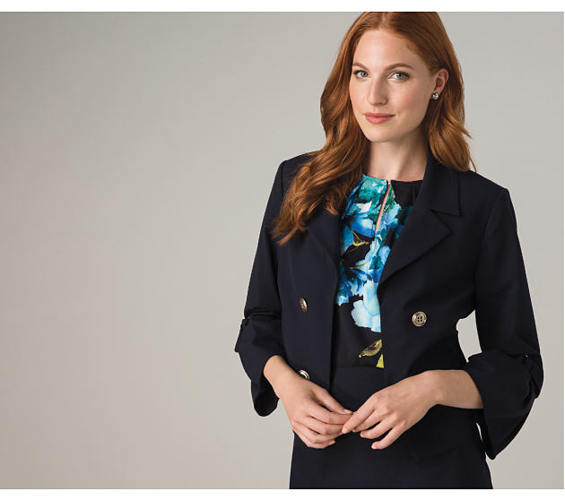 Woman in blue floral print top and navy blazer.