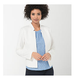 woman wearing white jacket and blue shirt