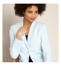 Model in light blue blazer.