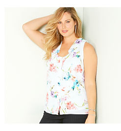 White blouse with multicolored floral print.
