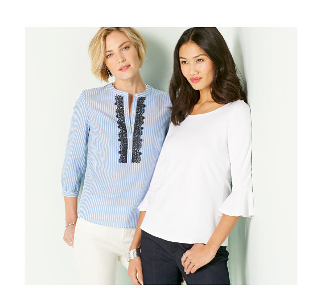 Model in light blue pinstripe blouse with black lace trim down front and white pants. Model in white bell-sleeve top and dark jeans.