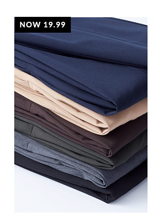 Stack of Signature Pants in a variety of colors.