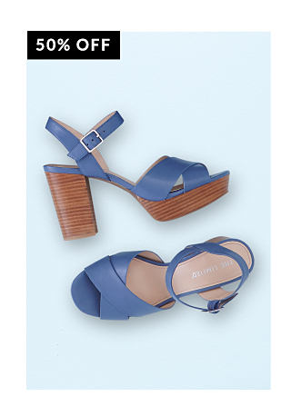 A pair of blue sandals with wooden platform heel.