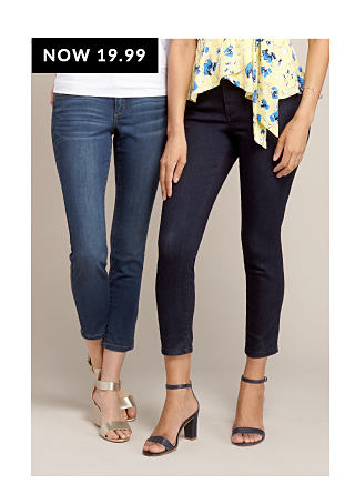 Model in white tee & medium wash cropped jeans. Model in yellow shirt with blue floral print & dark wash cropped jeans.