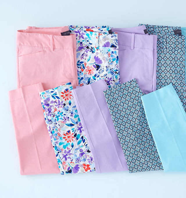 5 pairs of folded pants in assorted prints & pastel colors.