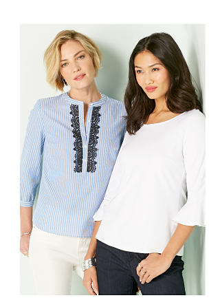 Model in light blue pinstripe blouse with black lace detail down front and white pants. Model in white bell-sleeve top with dark jeans.