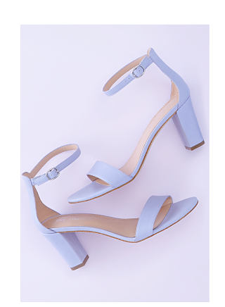A pair of lavender heeled sandals with ankle strap.