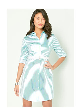Model in teal & white striped shirt-dress with rolled sleeves, buttons up front, & white belt.