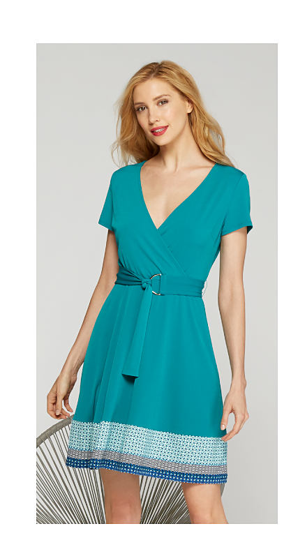 woman wearing short teal dress with v-neck