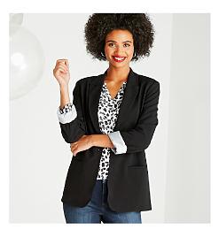 Model in black jacket, leopard print top, & jeans.
