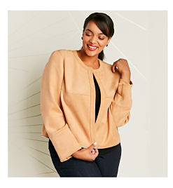 Model in tan jacket & dark pants.