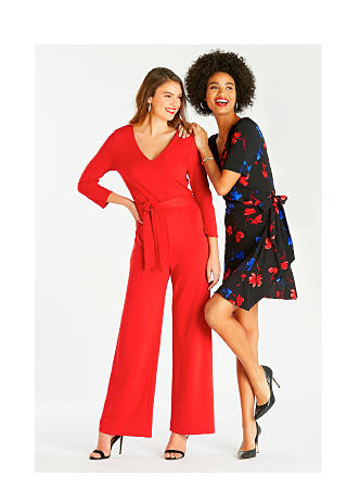 Model in red jumpsuit. Model in black dress with red & blue floral print.