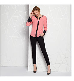 Model in pink blouse & black pants