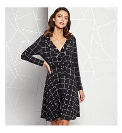 Model in black dress with white window pane print
