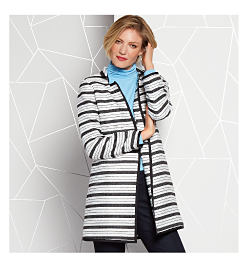 Model in black & white striped jacket, blue top, & dark pants