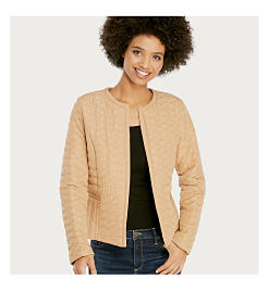 Model in tan quilted jacket, black shirt & jeans