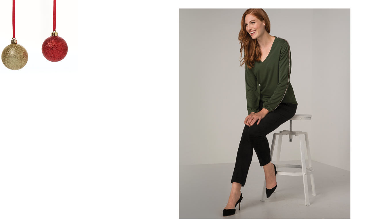 A woman wearing a dark green long sleeve top and black pants