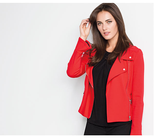 A woman wearing a red moto jacket