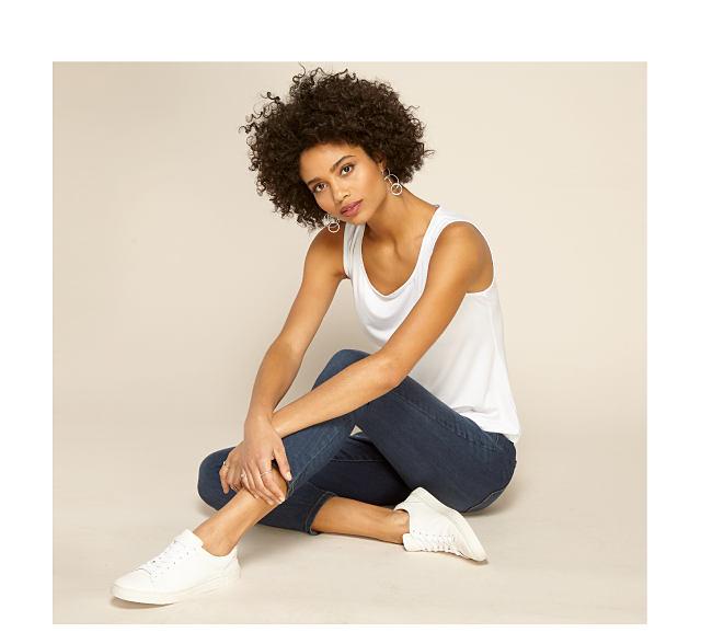 model in white tank & jeans