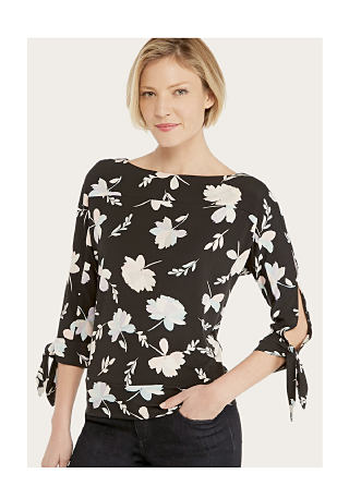 model in black & white floral print top