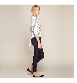 model in striped blouse & dark jeans