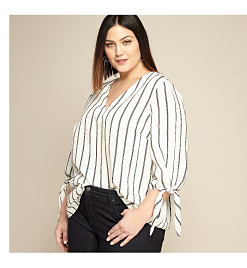 model in black & white striped top
