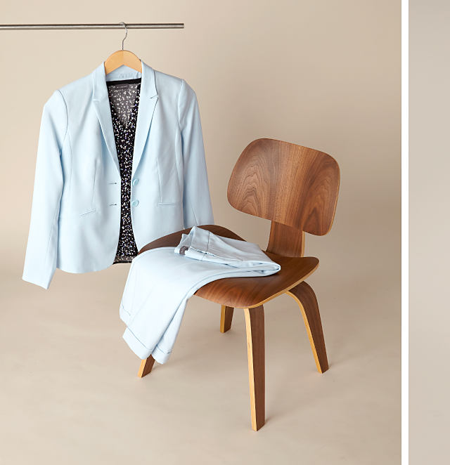 light blue suit jacket on a hanger & light blue dress pants folded in a chair