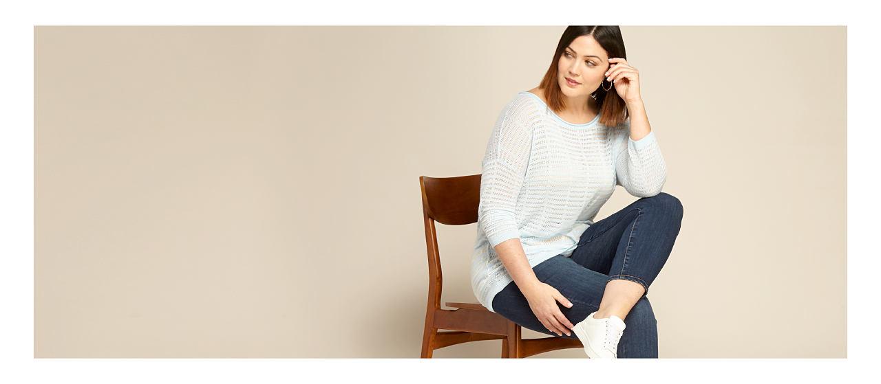 model in light sweater & jeans