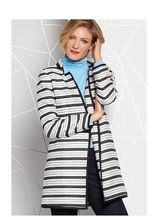 model in striped jacket, blue shirt & dark pants