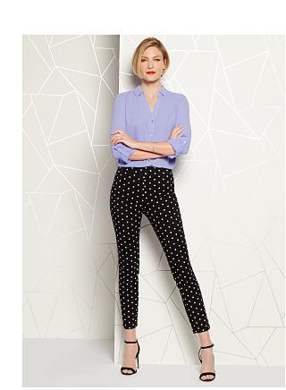 model in lavender blouse & black polka dot pants