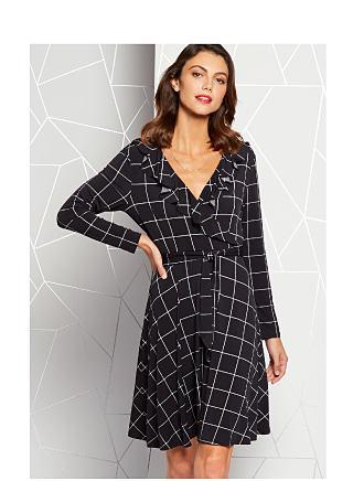 Model in black window pane print wrap dress