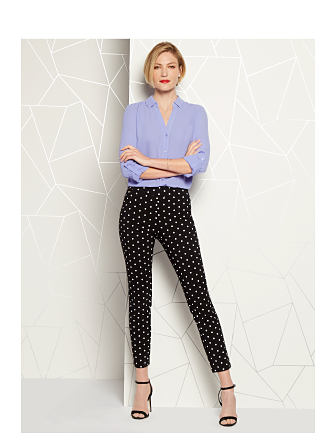 model in lavender blouse & black polka dot pants