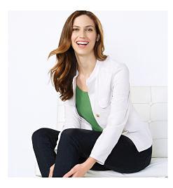woman wearing white jacket and blue shirt