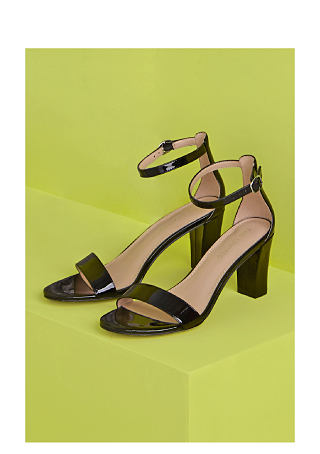 A pair of heeled sandals with ankle strap.