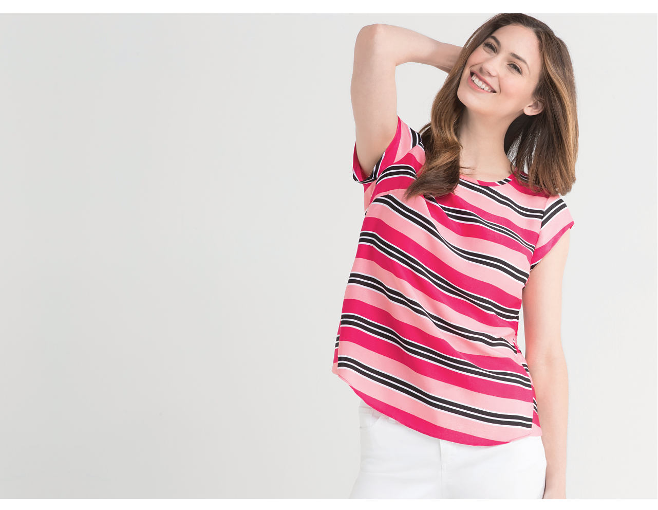 woman wearing a pink and black striped top