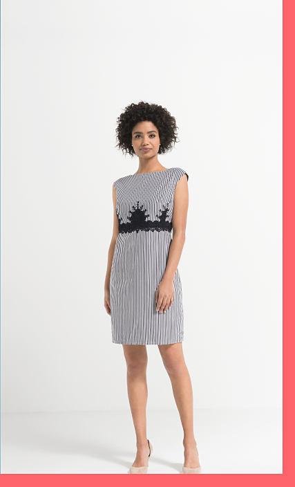 woman in plaid dress