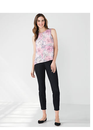 woman in floral top and black pants