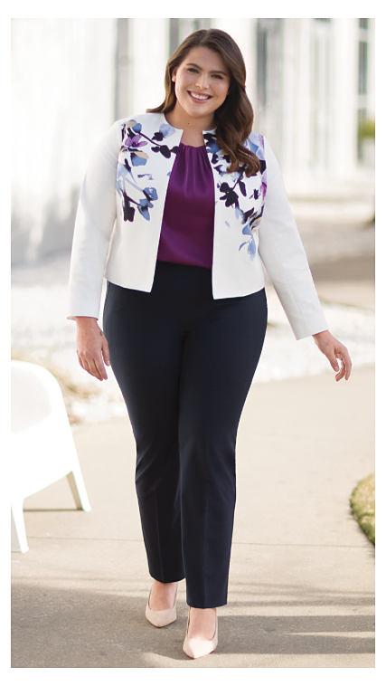A woman wearing a white floral print top.