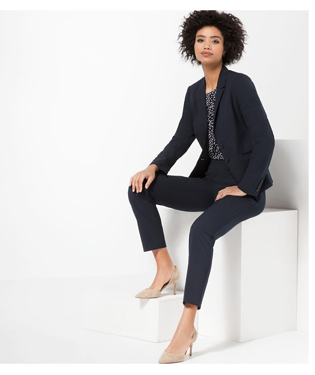 woman wearing business suit and nude pumps