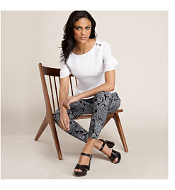 model in white top with button detail and black paisley print pants