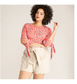 model in khaki shorts & red printed blouse