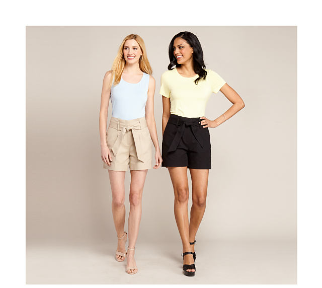 model in white tank top & khaki shorts with tie waist detail, model in yellow tee & black shorts with tie waist detail
