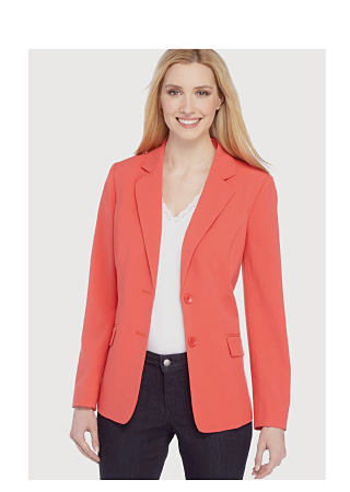 model in coral blazer, white top, & black pants