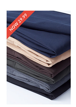 stack of signature pants in various colors