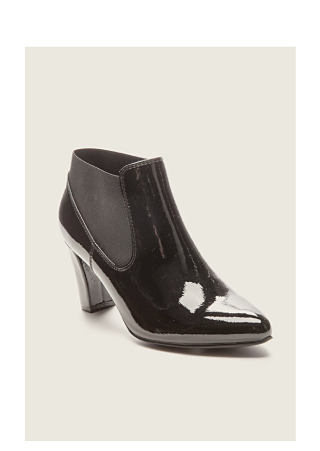 Black pointed-toe bootie. Time to reboot. Our newest arrivals. Shop shoes.