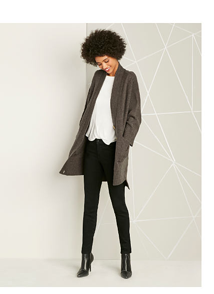 Model in grey cardigan & black pants