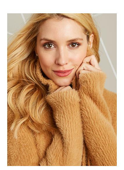 Model in tan, furry sweater