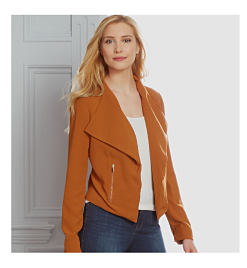 woman wearing rust jacket with white top