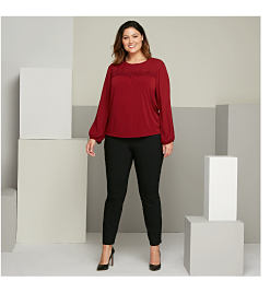 woman wearing red shirt black pants